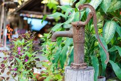 Old groundwater pump. In a garden, Closeup royalty free stock photography