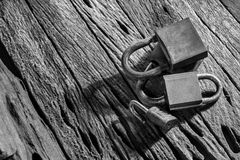 Old group of padlocks  on grunge wooden background. Royalty Free Stock Image