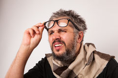 Old grumpy blind man Stock Photo