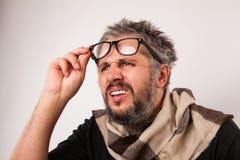 Old grumpy blind man Stock Photo