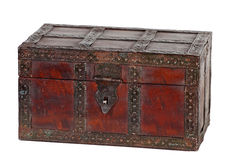 Old grunchy treasure chest. Old grungy wooden treasure chest with rusty metal decoration Royalty Free Stock Photos