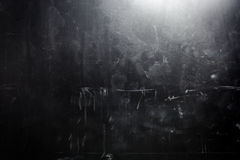 Old grunge black wall. Spot lighting Stock Photography