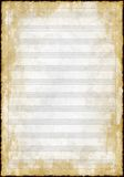 Old grunge blank music paper Stock Images