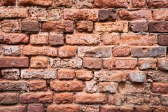 Old grunge brick wall background. Close up stock photography