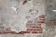 Old grunge brick wall and plaster royalty free stock images