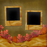 Old grunge card. On the abstract background with autumn leaves Royalty Free Stock Photography