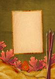 Old grunge card with autumn leaves an Stock Images