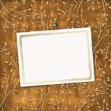 Old grunge card on the ornamental background. Old grunge card on the leafage ornamental background Stock Photos