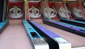 Old Grunge Carnival Games. Grungy old carnival games; roll the ball into the holes to get points Stock Images