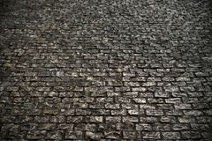 Old grunge cobble stone road surface background texture Royalty Free Stock Image
