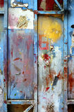 Old grunge color paint on metal wall background Stock Photos