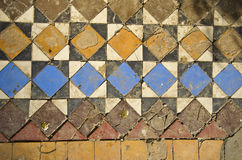 Old grunge colorful floor tiles background Stock Photo