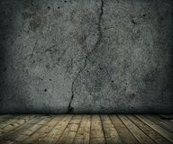 Old grunge concrete room with wooden floor Stock Images