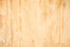 Old grunge cracked orange concrete wall Royalty Free Stock Photography