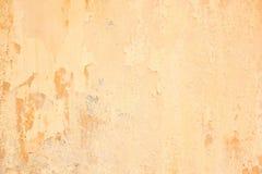 Old grunge cracked orange concrete wall Stock Photo