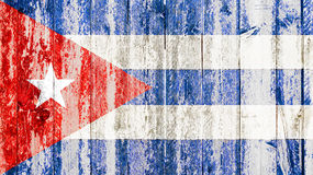 Old grunge cuban flag on broken crack wood with rift, havana cuba communist dictatorship. Pray for president concept royalty free stock images