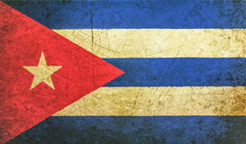 Old grunge cuban flag with rift, cuba communist dictatorship. Pray for president concept royalty free stock images