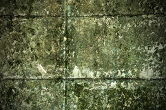 Old grunge decay wall with crumbling paint Royalty Free Stock Image