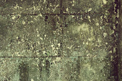 Old grunge decay wall with crumbling paint Stock Image