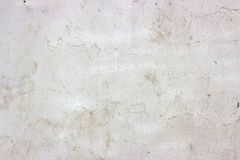 Old grunge dirty cracked vintage light grey concrete and cement mold texture wall or floor background with weathered paint royalty free stock images
