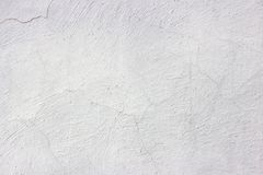 Old grunge dirty cracked vintage light grey concrete and cement mold texture wall or floor background with weathered paint stock photo