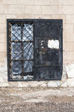 Old Grunge Door in Black and Brick Wall. Single old style grunge door in black set in a white brick wall Royalty Free Stock Photo