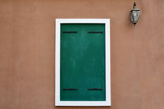 Old grunge door, colonial style. With lamp post Stock Photos
