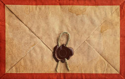Old grunge envelope with sealing wax. Old grunge envelope with sealing wax and rope Royalty Free Stock Image