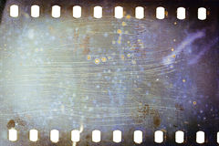 Old grunge filmstrip. Blank grained moldy film strip texture background Royalty Free Stock Photos