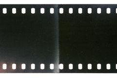 Old grunge filmstrip. Blank scratched noisy gray filmstrip isolated on white background stock image
