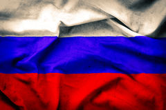 Old grunge flag of Russia. Waving fabric background Stock Photography