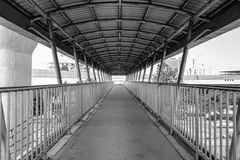 Old grunge foot bridge or overpass. In black and white filter for background Stock Image