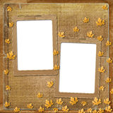Old grunge frame with autumn leaves Stock Photography