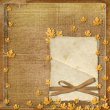 Old grunge frame with autumn leaves Stock Photos