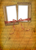 Old grunge frame with ribbons and bow Stock Photography
