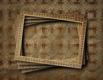 Old grunge frames on the ancient background Royalty Free Stock Images