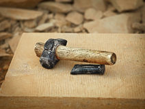 Old grunge hammer and metal boaster Royalty Free Stock Photo