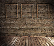 Old grunge interior with blank frames stock images