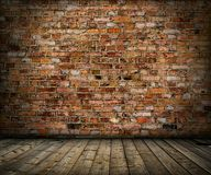 Old grunge interior with brick wall and floor. Old grunge interior with brick brown wall and floor Stock Photo