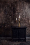 Old grunge interior with candles Royalty Free Stock Photography