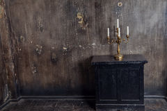 Old grunge interior with candles Stock Photos