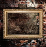 Old grunge interior frame. Against destroyed wall Stock Images