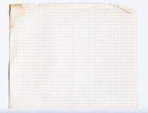 Old grunge lined notebook sheet. Background Stock Image
