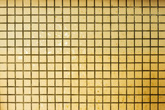 Old grunge mosaic wall. Yellow wall backgrounds. Royalty Free Stock Image