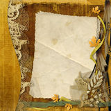 Old grunge paper with autumn leaves Stock Photos