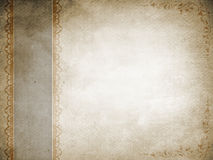 Old grunge paper background with decorative patterns. Royalty Free Stock Photo