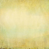 Old grunge paper background with. Delicate abstract canvas texture and blue sky and landscape view Stock Photos