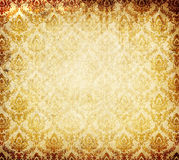 Old grunge paper background with vintage ornament. Royalty Free Stock Image