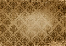 Old grunge paper background with vintage patterns. Royalty Free Stock Image