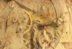 Old grunge paper with clockwork mechanism Stock Image